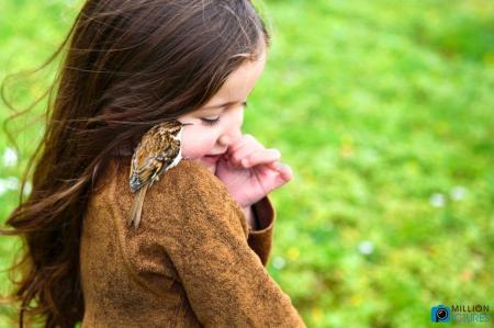 little-girl-making-friend-with-a-bird